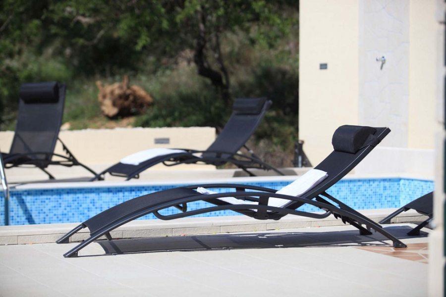Pool with sun lounges at villa Majda